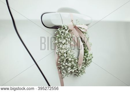 Door Handle Of A Car Decorated With Flowers Of Gypsophila