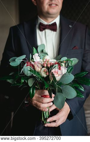 Groom Is Holding A Wedding Colorful Bouquet. Beauty Of Colored Flowers.