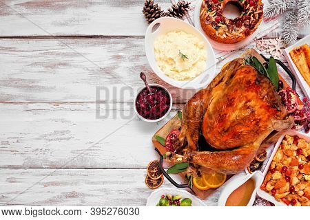 Traditional Christmas Turkey Dinner. Overhead View Side Border On A Rustic White Wood Background. Tu