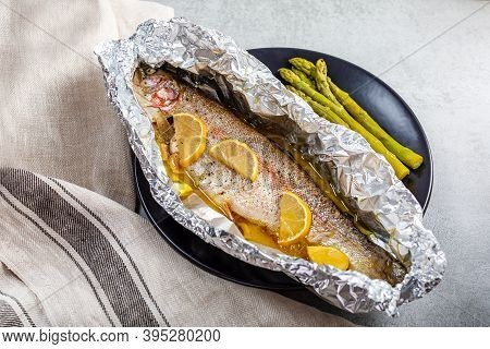 Fresh Baked Salmon Trout In An Aluminum Foil