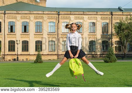 Active Child In Uniform With School Bag Enjoy Jumping In Schoolyard, Childhood.