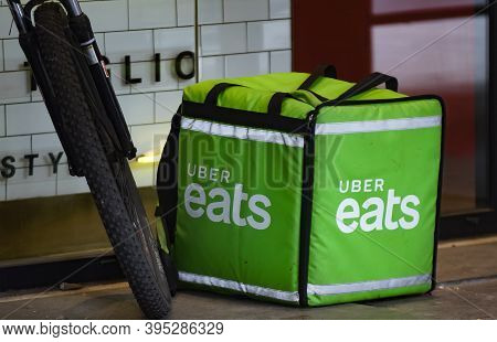 Bucharest, Romania - November 12, 2020: An Uber Eats Food Delivery Courier Delivers Food In Buchares