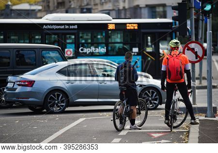 Bucharest, Romania - November 04, 2020: People On Bicycles Are Waiting To Cross The Street On The Bi