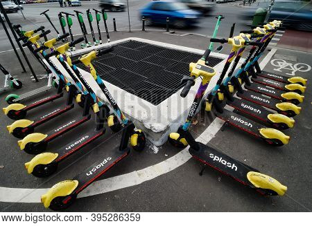 Bucharest, Romania - November 03, 2020: Splash Electric Scooters Are Parked On A Sidewalk In Buchare