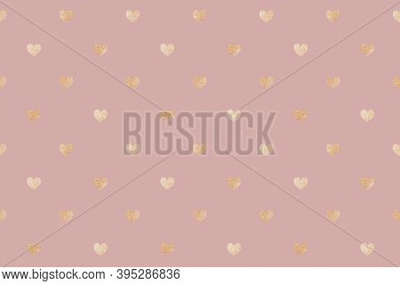 Seamless glittery gold hearts patterned background