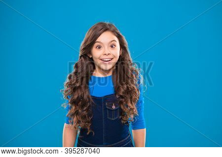 Kid Girl Long Healthy Shiny Hair Wear Casual Clothes. Little Girl Excited Happy Face. Kid Happy Cute