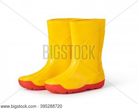 yellow rubber boots isolated on white background