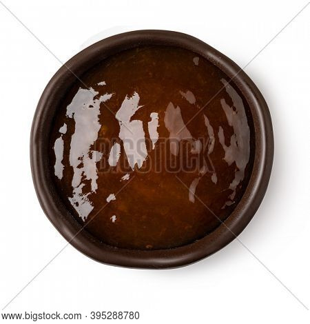 glass bowl of apricot jam isolated on white background