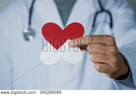 closeup of a doctor man, in a white coat, showing an antibiotic resistance symbol in his hand