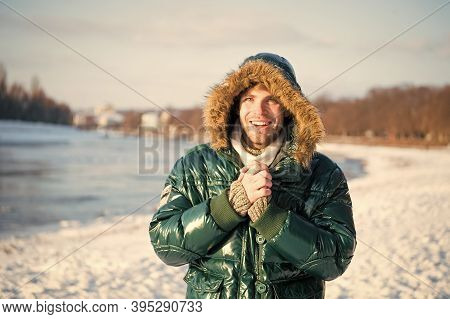 Man Warm Jacket Snowy Nature Background. Wind Resistant Clothes. Winter Favorable Weather Conditions