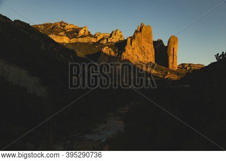 Mountains Of The Mallos De Riglos, Vertical Rock Walls At Sunset, A Famous Place For Climbing Near T