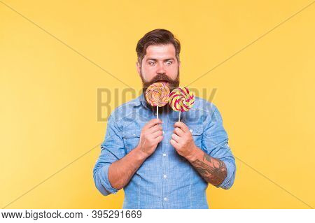 Dont Let Hunger Happen To You. Surprised Hipster Look At Lollipops. Enjoying Candy Snack. Unhealthy