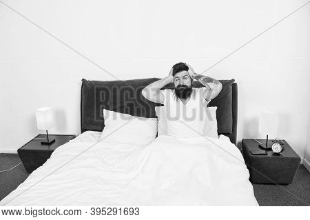 Hangover Effect. Hipster Got Terrible Headache In Morning. Bearded Man Suffer From Headache In Bed.