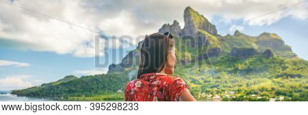 Travel tourist adventure wanderlust influencer girl banner panoramic on Bora Bora island, Tahiti. Woman exploring nature hiking trail in French Polynesia. Mount Otemanu summer background.