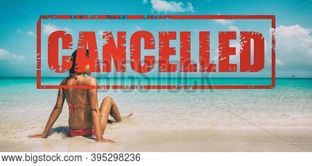 CANCELLED stamp onBeach travel vacation for winter holidays cancelled due to coronavirus. Woman in bikini in Caribbean. Happy Christmas girl on cruise vacation sun tanning banner.