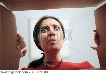 Disappointed Woman Looking Inside Cardboard Gift Box