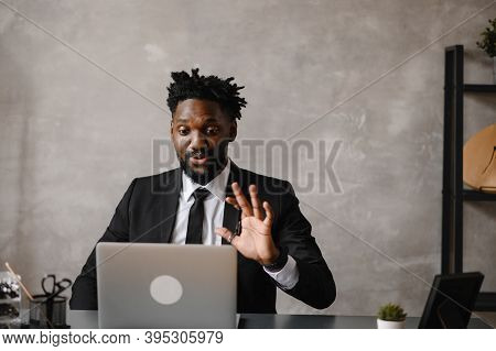 Confident Young African Man Look At Webcam Conference Video Calling In Office, Happy Mixed Race Entr