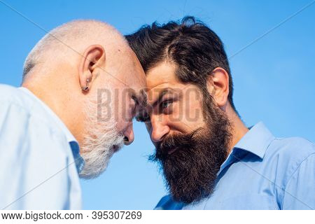 Men Generations: Grandfather And Father Together. Elderly Senior Man And Bearded Son - Two Generatio