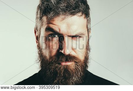 Serious Stylish Bearded Man. Handsome Young Man Isolated. Close Up Portrait Of Severe Hot Bearded Gu