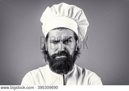 Portrait Of A Serious Chef Cook. Confident Bearded Male Chef In White Uniform. Serious Cook In White