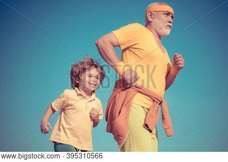 Jog And Run Marathon For Family. Grandpa And Child Sportsmen Jogging Outdoors And Enjoying Sunny Day