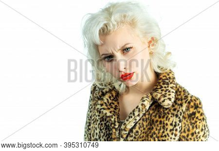 Beauty Of Girl. Beautiful Woman With Beauty Makeup And Blond Hair Wearing Leopard Print Coat. Beauty