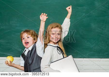 Woohoo. Cheerful Smiling Child At The Blackboard. Schoolchild. Book School And Kids. Classroom. Scho