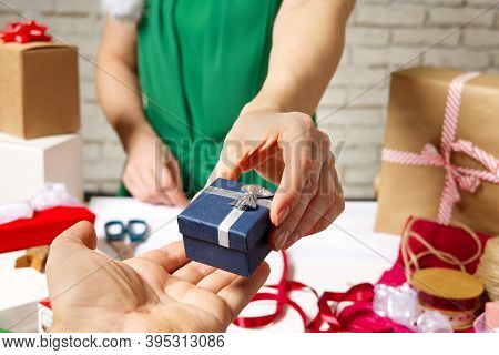 Female Hands Holding Packed Present For Christmas Festive Backdrop For Holidays Birthday, Valentines