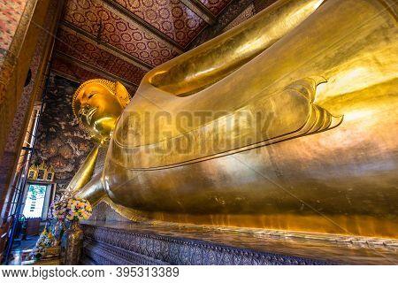 Bangkok, Thailand - December 7, 2019: Reclining Buddha Statue In Thailand Buddha Temple Wat Pho, Asi