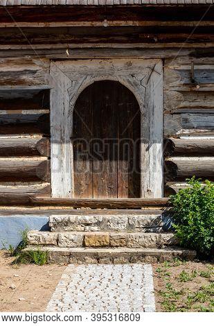 Wooden Door In Rustic Old Peasant House