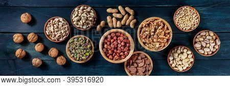 Nuts Panorama. Walnuts And Cashews, Peanuts, And Hazelnuts, Almonds, Pine Nuts And Pistachios, Overh