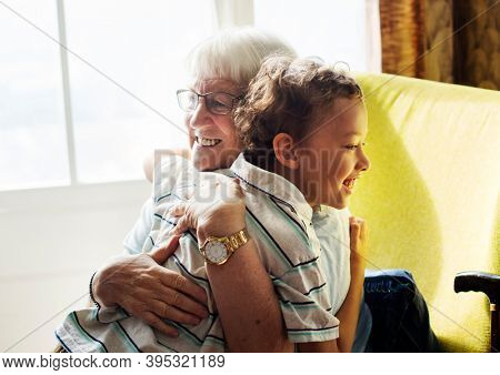 Grandma and grandson hugging after social distancing