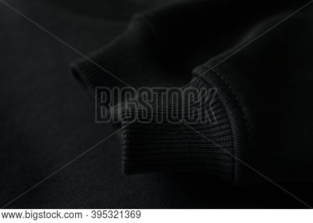 Sleeve Of Black Sweatshirt, Close Up And Space For Tet