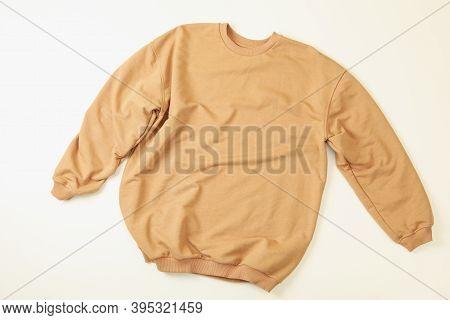 Blank Beige Sweatshirt On White Background, Top View