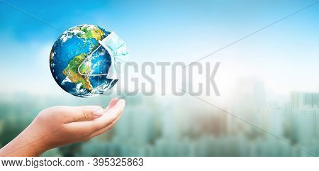 Earth Is Wearing Protection Mask On Nature Blurred Background ,elements Of This Image Furnished By N