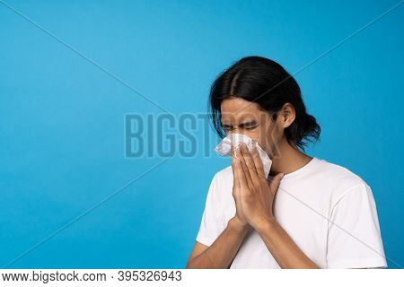 A Young Man Is Wiping The Toilet Paper With Water On Nose, Feeling Sick, Coughing, Sneezing. Concept