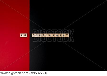 Horizontal Color Image With An Overhead View Of A  Wooden Letters On A Red And Black Background Form