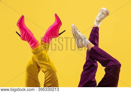 Jocosity. Fashion Model's Feet In Bright Stylish Footwear White, Pink Isolated On Yellow Background.