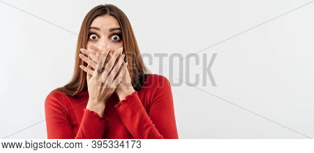 I'm Afraid. Image Of Young Scared Woman With Long Chestnut Hair In Casual Red Sweater Covering Her M