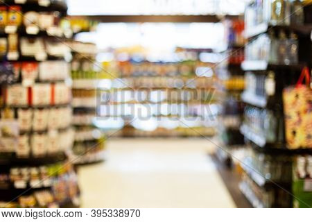 Blurred Supermarket Background, Defocused Grocery Store Aisles With Food And Drinks On Aisles. Unrec