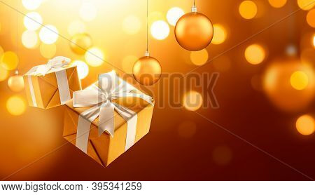 Gold Christmas Gifts And Hanging Bauble Against Bokeh Lights Background