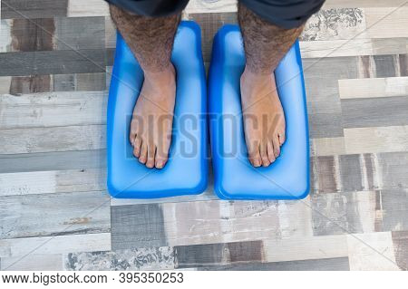 Man's Feet On A Pressure Platform To Make Orthotics For The Shoes