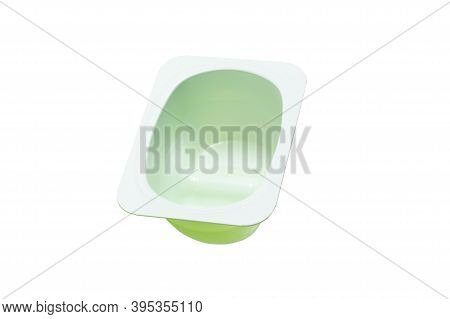 Empty Clean Plastic Yoghurt Cup Isolated On White Background. Food Grade Biodegradable Container