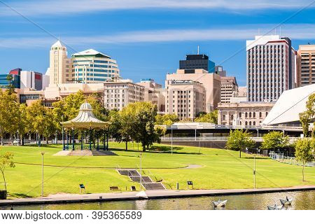 Adelaide City Skyline With Iconic Rotunda Viewed Across Elder Park On A Bright Day