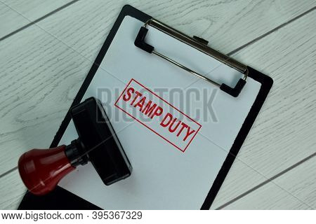 Red Handle Rubber Stamper And Stamp Duty Text Isolated On The Table.