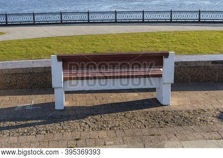Stylish Bench In A Summer Park Made Of Concrete And Wood.