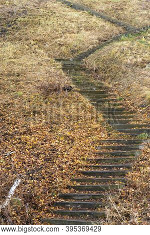 Beautiful Way Up On The Stone Stairs With Plenty Fallen Autumn Leaves On Them.