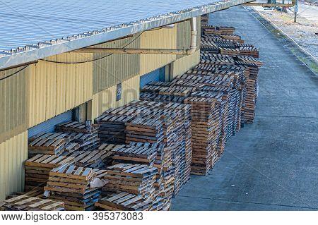New Orleans, La - November 14: Pallets Rest On Warehouse Dock Along Mississippi River On November 14
