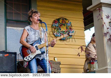 New Orleans, La - November 14: Guitarist Performs During Front Porch Concert In Uptown Neighborhood
