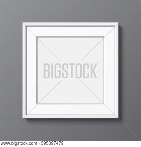Square White Frame With Passepartout Hanging On A Grey Wall. Blank Elegant Frame Template, With Clea